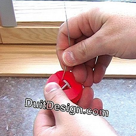 Unclip the red round cord ends