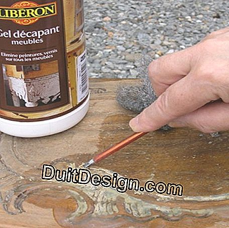 Use a gouge to remove the paint