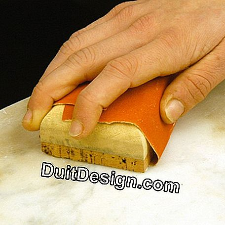 Lightly sand the marble to remove stubborn stains
