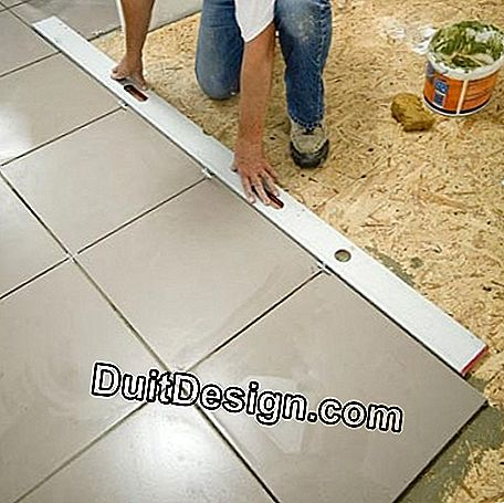 Check the tile alignment with a large metal ruler
