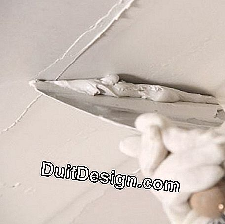 Scrape from bottom to top to spread the plaster