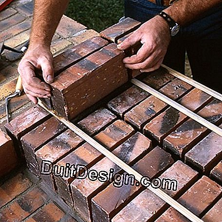 Facing brick barbecue on breeze blocks: breeze
