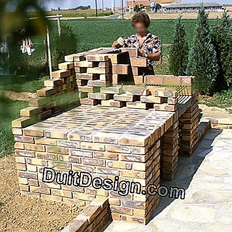 Facing brick barbecue on breeze blocks: brick