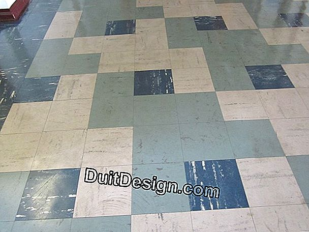 Tile on vinyl containing asbestos