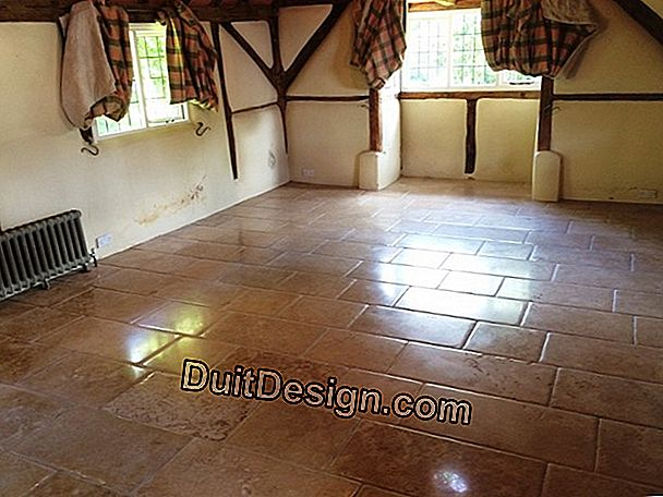 Terracotta floor stained by a water leak