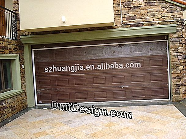 A motorized sectional garage door