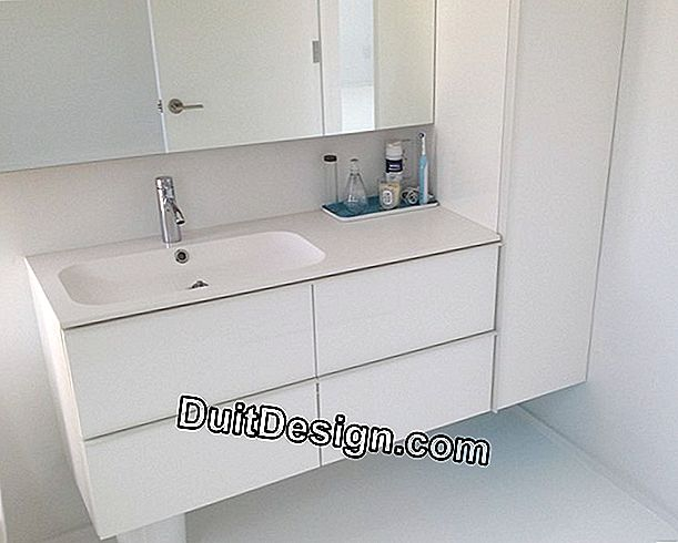 Take off a basin from a bathroom cabinet