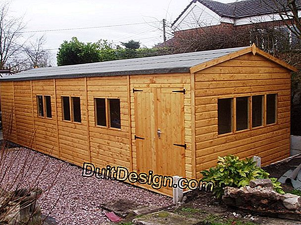 A wooden construction for a garage and a workshop
