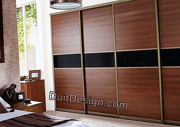 Install sliding cupboard doors