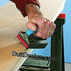 sanding the closet panels in medium