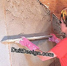 Smoothing the wall with a mason ruler