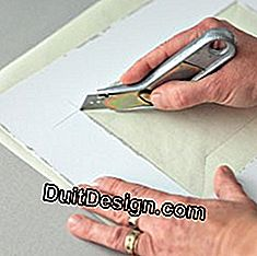 cutting the paper with a cutter