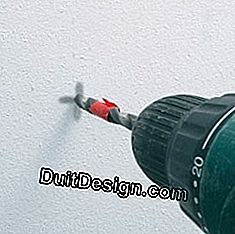 to drill a wall with a drill