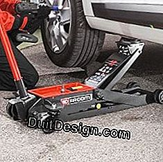Use the jack on a flat, hard surface to lift a car
