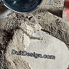 pour water into the cement-sand mixture
