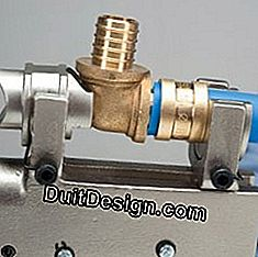 slide the bushing on the tube up to the shoulder of the fitting