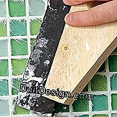 Grout a glass mosaic plate with mortar