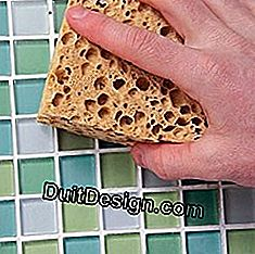 Remove excess mortar from a mosaic tile with a sponge