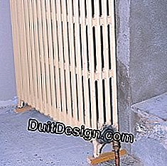 Fix the radiator to the wall