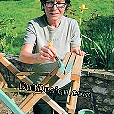 Paint the wooden structure of the canvas chair