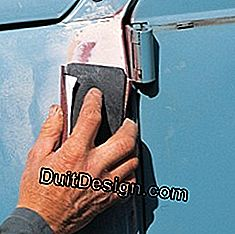 sanding a car repair sealant